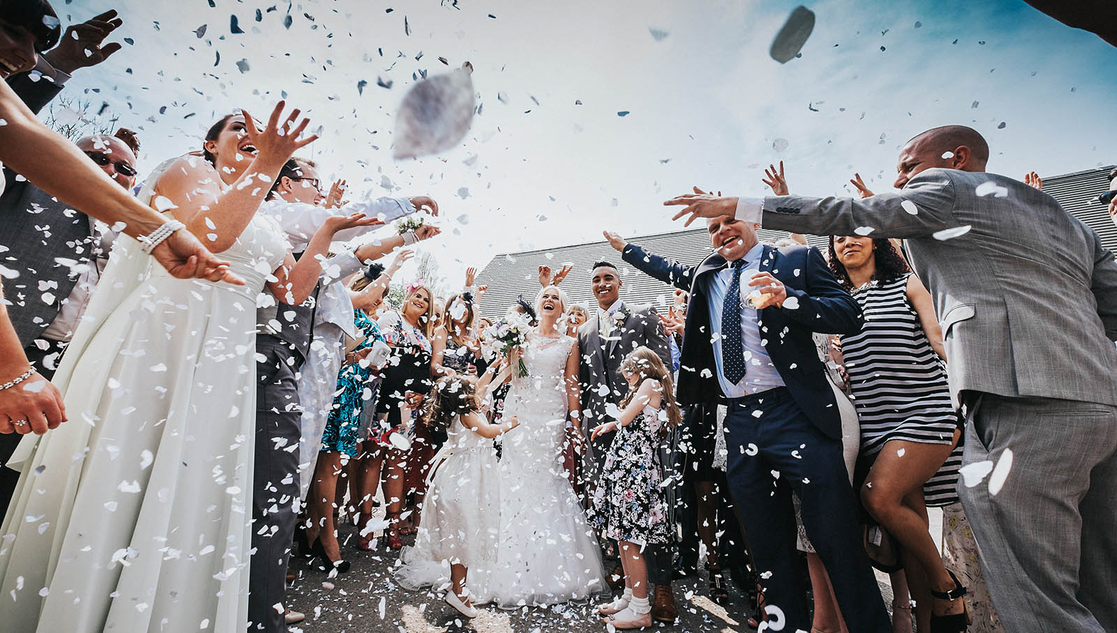 Newlyweds and confetti photography by Staffordshire wedding photographer bib & tucker