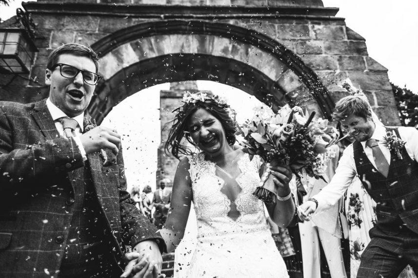fun wedding photography, lots of cofetti, cheshire wedding photographer, alcumlow wedding barn, staffordshire wedding photography